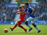 Alberto Moreno of Liverpool is closed down by Tyias Browning of Everton during the Barclays Premier League match between Everton and Liverpool at Goodison Park on October 4, 2015 in Liverpool, England.
