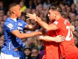 Liverpool's English midfielder James Milner (2R) holds Liverpool's German midfielder Emre Can (R) back from Everton's Zimbabwean midfielder Brendan Galloway (L) during a scuffle during of the English Premier League football match between Everton and Liver