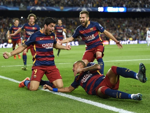 Barcelona's Uruguayan forward Luis Suarez celebrates a goal with his teammates during the UEFA Champions League football match FC Barcelona vs Bayer Leverkusen at the Camp Nou stadium in Barcelona on September 29, 2015.
