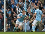 Manchester City's Belgian midfielder Kevin De Bruyne celebrates after scoring their fourth goal during the English Premier League football match between Manchester City and Newcastle United at The Etihad Stadium in Manchester, north west England on Octobe