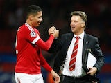 Louis van Gaal manager of Manchester United celebrates victory with winning goalscorer Chris Smalling in the UEFA Champions League Group B match between Manchester United FC and VfL Wolfsburg at Old Trafford on September 30, 2015