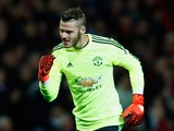 David De Gea of Manchester United celebrates as Juan Mata of Manchester United (not pictured) scores their first and equalising goal from the penalty spot during the UEFA Champions League Group B match between Manchester United FC and VfL Wolfsburg at Old