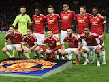 Manchester United's English forward Wayne Rooney (front row C) poses with teammates ahead of the UEFA Champions League Group B football match between Manchester United and VfL Wolfsburg at Old Trafford in Manchester, north west England, on September 30, 2