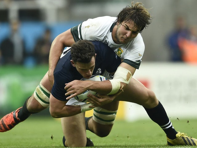 Scotland's centre Matt Scott (L) is tackled by South Africa's lock Lood de Jager during a Pool B match of the 2015 Rugby World Cup between South Africa and Scotland at St James' Park in Newcastle-upon-Tyne, north east England on October 3, 2015