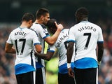 Aleksandar Mitrovic (2nd L) of Newcastle United celebrates scoring his team's first goal with his team mates during the Barclays Premier League match between Manchester City and Newcastle United at Etihad Stadium on October 3, 2015