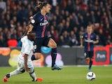 Paris Saint-Germain's Swedish forward Zlatan Ibrahimovic (2ndL) vies with Marseille's French midfielder Lassana Diarra during the French L1 football match Paris Saint-Germain (PSG) vs Olympique de Marseille (OM) on October 4, 2015