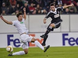 Partizan's Serbian striker Andrija Zivkovic (R) scores the first goal during the UEFA Europa League first-leg Group L football match FC Augsburg v FK Partizan in Augsburg, southern Germany on October 1, 2015