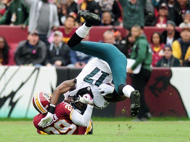 Nelson Agholor #17 of the Philadelphia Eagles is tackled by Chris Culliver #29 of the Washington Redskins at FedExField on October 4, 2015