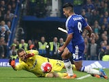 Chelsea's Colombian striker Radamel Falcao (R) is brought down in the area by Southampton's Dutch goalkeeper Maarten Stekelenburg during the English Premier League football match between Chelsea and Southampton at Stamford Bridge in London on October 3, 2