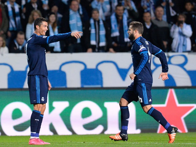 Real Madrid's Portuguese forward Cristiano Ronaldo celebrates after scoring the opening goal with his teammate Spanish defender Nacho (R) during the UEFA Champions League first-leg Group A football match between Malmo FF and Real Madrid CF at the Swedbank