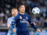 Real Madrid's Portuguese forward Cristiano Ronaldo (R) and Malmo's Norwegian midfielder Jo Inge Berget vie for the ball during the UEFA Champions League first-leg Group A football match between Malmo FF and Real Madrid CF at the Swedbank Stadion, in Malmo