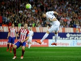 Karim Benzema of Real Madrid scores Real's opening goal during the La Liga match between Club Atletico de Madrid and Real Madrid at Vicente Calderon Stadium on October 4, 2015