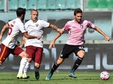 Franco Vazquez (R) of Palermo is challenged by Radja Nainggolan (C) and Miralem Pjanic of Roma during the Serie A match between US Citta di Palermo and AS Roma at Stadio Renzo Barbera on October 4, 2015 in Palermo, Italy.
