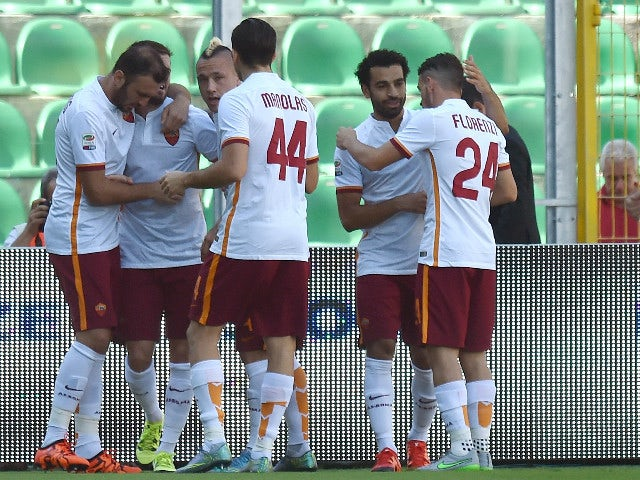 Miralem Pjanic of Roma celebrates with team mates after scoring the opening goal during the Serie A match between US Citta di Palermo and AS Roma at Stadio Renzo Barbera on October 4, 2015 in Palermo, Italy.