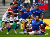 Alesana Tuilagi of Samoa is tackled during the 2015 Rugby World Cup Pool B match between Samoa and Japan at Stadium mk on October 3, 2015