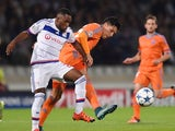 Lyon's French defender Samuel Umtiti (L) vies with Valencia's midfielder Dani Parejo (R) during the Champions League group H football match between Lyon and Valencia on September 29, 2015 at the Gerland stadium in Lyon, central-eastern France.