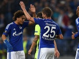 Schalke's Dutch striker Klaas-Jan Huntelaar and Schalke's midfielder Leroy Sane celebrate during the UEFA Europa League first-leg Group K football match FC Schalke 04 v Asteras Tripolis FC in Gelsenkirchen, western Germany on October 1, 2015