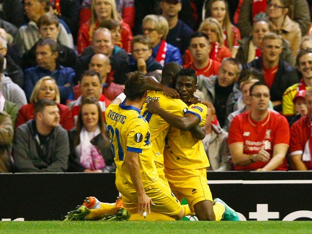 Ebenezer Assifuah of FC Sion celebrates scoring their first goal with team mates during the UEFA Europa League group B match between Liverpool FC and FC Sion at Anfield on October 1, 2015