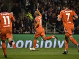 Valencia's Algerian midfielder Sofiane Feghouli (C) celebrates after scoring a goal during the Champions League group H football match between Lyon and Valencia on September 29, 2015 at the Gerland stadium in Lyon, central-eastern France.
