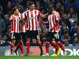 Sadio Mane of Southampton celebrates scoring his team's second goal with his team mates during the Barclays Premier League match between Chelsea and Southampton at Stamford Bridge on October 3, 2015 in London, United Kingdom.