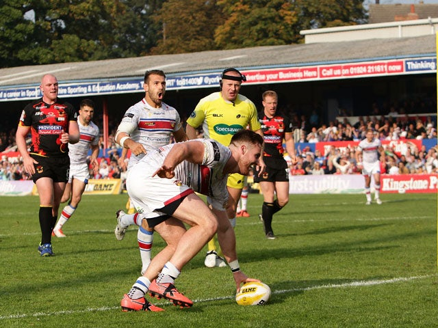 Anthony Mullally of Wakefield Wildcats scores a try during the Million Pound Game between Wakefield Wildcats and Bradford Bulls at Belle Vue Stadium on October 3, 2015