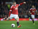 Manchester United's English striker Wayne Rooney kicks the ball during the English League Cup third round football match between Manchester United and Ipswich Town at Old Trafford in Manchester, north west England on September 23, 2015.