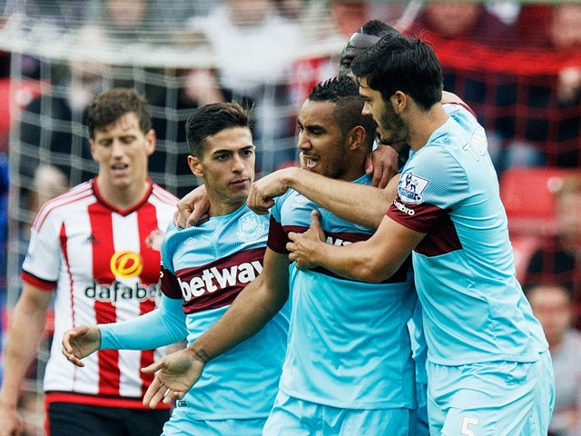 Dimitri Payet (2nd R) of West Ham United celebrates scoring his team's second goal with his team mates during the Barclays Premier League match between Sunderland and West Ham United at the Stadium of Light in Sunderland on October 3, 2015