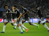 Chelsea's Brazilian midfielder Willian (L) celebrates a goal with teammates during the UEFA Champions League Group G football match at the Dragao stadium in Porto on September 29, 2015.
