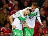 Daniel Caligiuri of VfL Wolfsburg (L) celebrates with Bas Dost as he scores their first goal during the UEFA Champions League Group B match between Manchester United FC and VfL Wolfsburg at Old Trafford on September 30, 2015