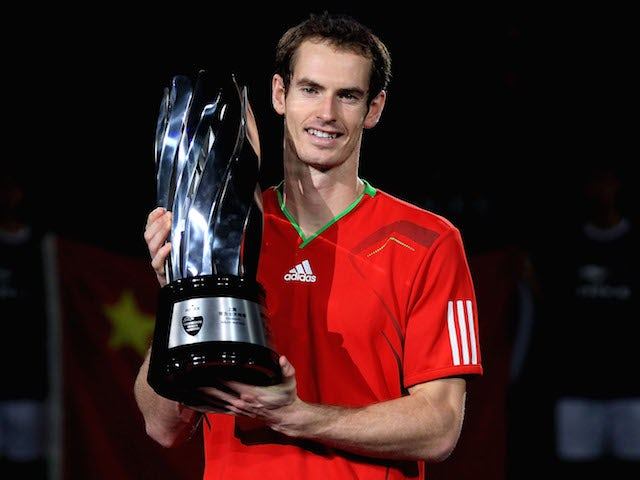 Andy Murray of Great Britain poses for photographers after defeating David Ferrer of Spain during the final of the Shanghai Rolex Masters at the Qi Zhong Tennis Center on October 16, 2011 in Shanghai, China.