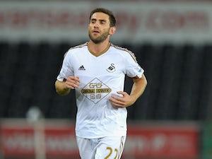 Swansea City lift survival hopes