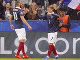 France's forward Antoine Griezmann (R) celebrates with France's forward Karim Benzema after scoring a goal during the friendly football match between France and Armenia on October 8, 2015 at the Allianz Riviera stadium in Nice, southeastern France.