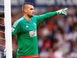 Boaz Myhill of West Bromwich Albion gives instructions during the Barclays Premier League match between West Bromwich Albion and Chelsea at the Hawthorns on August 23, 2015