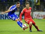 Aaron Ramsey (R) of Wales in action against Anel Hadzic (L) of Bosnia during the Euro 2016 qualifying football match between Bosnia and Herzegovina and Wales at the Stadium Bilino Polje in Elbasan on October 10, 2015.