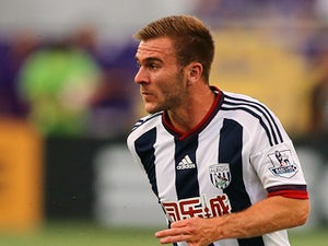 Callum McManaman #19 of West Bromwich Albion stops a ball during an International friendly soccer match between West Bromwich Albion and the Orlando City SC at the Orlando Citrus Bowl on July 15, 2015 in Orlando, Florida. Orlando won the match 3-1.