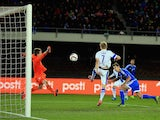 Craig Cathcart of Northern Ireland scores the opening goal during the UEFA EURO 2016 Qualifying match between Finland and Northern Ireland at the Olympic Stadium on October 11, 2015 in Helsinki, Finland.