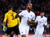 Theo Walcott of England celebrates scoring during the UEFA EURO 2016 Group E qualifying match between England and Estonia at Wembley on October 9, 2015 in London, United Kingdom.