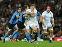 Owen Farrell of England is tackled during the 2015 Rugby World Cup Pool A match between England and Uruguay at Manchester City Stadium on October 10, 2015 in Manchester, United Kingdom.