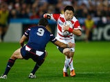 Fumiaki Tanaka of Japan looks to go past Mike Petri of the United States during the 2015 Rugby World Cup Pool B match between USA and Japan at Kingsholm Stadium on October 11, 2015 in Gloucester, United Kingdom.