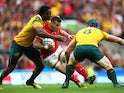 Gareth Davies of Wales takes on Tevita Kuridrani (L) of Australia during the 2015 Rugby World Cup Pool A match between Australia and Wales at Twickenham Stadium on October 10, 2015