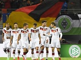 Germany's players react after scoring the 2-1 during the Euro 2016 Group D qualifying football match between Germany and Georgia in Leipzig, eastern Germany, on October 11, 2015.