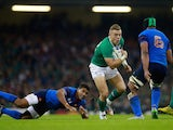 Ian Madigan of Ireland looks to break with the ball during the 2015 Rugby World Cup Pool D match between France and Ireland at Millennium Stadium on October 11, 2015 in Cardiff, United Kingdom.