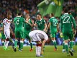 James McCarthy of Republic of Ireland (C) celebrates victory with team mates after the UEFA EURO 2016 Qualifier group D match between Republic of Ireland and Germany at the Aviva Stadium on October 8, 2015 in Dublin, Ireland.