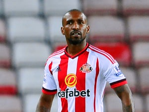 Jermain Defoe of Sunderland leaves the pitch with the match ball after scoring a hat-trick during the Capital One Cup Second Round match between Sunderland and Exeter City at Stadium of Light on August 25, 2015 in Sunderland, England.