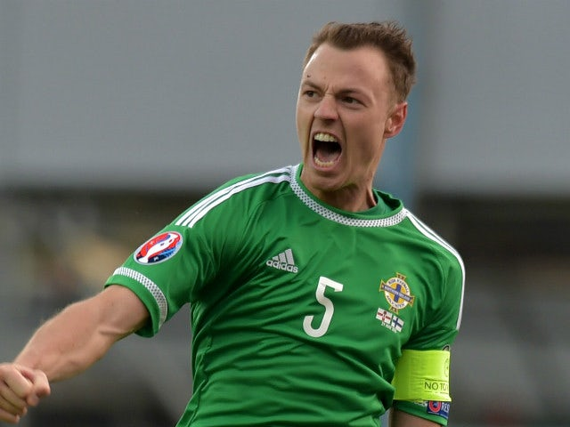Jonny Evans of Northern Ireland celebrates after the EURO 2016 Group F qualifier at Windsor Park on March 29, 2015 in Belfast, Northern Ireland.
