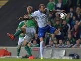 Josh Magennis of Northern Ireland (L) and Vangelis Moras of Greece (R) during the Euro 2016 Group F international football match at Windsor Park on October 8, 2015 in Belfast, Northern Ireland.
