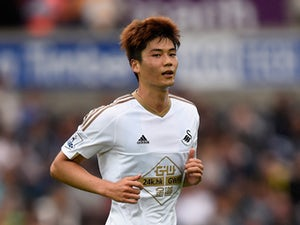 Swansea player Ki Sung-Yueng in action during the Pre season friendly match between Swansea City and Deportivo La Coruna at Liberty Stadium on August 1, 2015