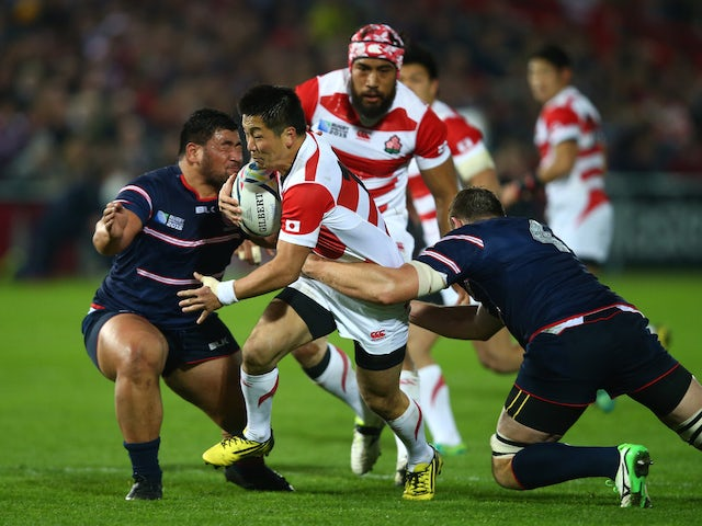 Kotaro Matsushima of Japan is held back during the 2015 Rugby World Cup Pool B match between USA and Japan at Kingsholm Stadium on October 11, 2015 in Gloucester, United Kingdom.