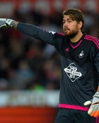 Swansea goalkeeper Kristoffer Nordfeldt in action during the Capital One Cup Second Round match between Swansea City and York City at Liberty Stadium on August 25, 2015