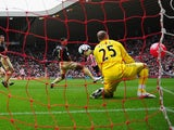 Darren Bent of Sunderland watches as his shot goes between Glen Johnson and Pepe Reina of Liverpool and in to the goal off of a balloon, during the Barclays Premier League match between Sunderland and Liverpool at the Stadium of Light on October 17, 2009